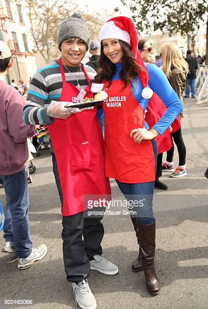 Johnny Ortiz and Deana Molle are seen at the annual Los Angeles Mission Christmas Dinner on December 24 2015 in Los Angeles California