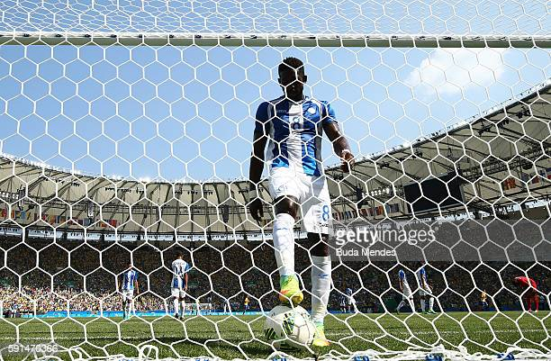 Johnny Palacios of Honduras collects the ball from the net after Gabriel Jesus of Brazil scored during the Men's Semifinal Football match between...