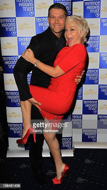 Johnny Partridge and Denise Welch attend the Terrence Higgins Trust's The Supper Club at Cafe de Paris on November 2 2010 in London England