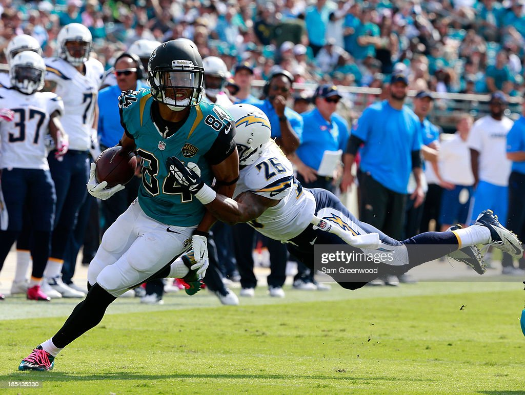 Johnny Patrick #26 of the San Diego Chargers attempts to tackle Cecil Shorts #84 of the Jacksonville Jaguars during the game at EverBank Field on October 20, 2013 in Jacksonville, Florida.