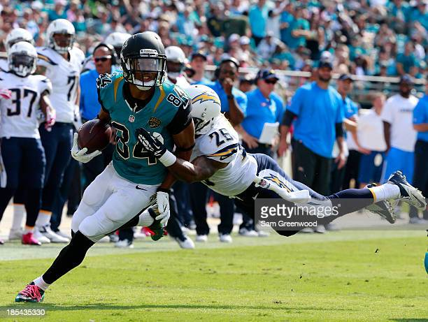 Johnny Patrick of the San Diego Chargers attempts to tackle Cecil Shorts of the Jacksonville Jaguars during the game at EverBank Field on October 20...