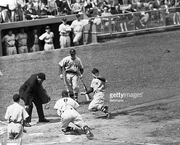 Johnny Pesky, Boston shortstop, is running into a mess of trouble. That's Bill Dickey waiting for him at home plate with the all he got from Yankee...