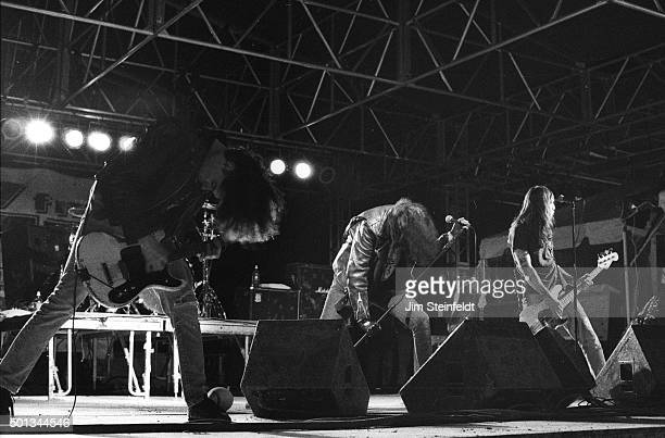 Johnny Ramone, Joey Ramone, and C.J. Ramone perform with the Ramones at Edge Fest 2 at Float-Rite Park in Somerset, Wisconsin on May 28, 1995.