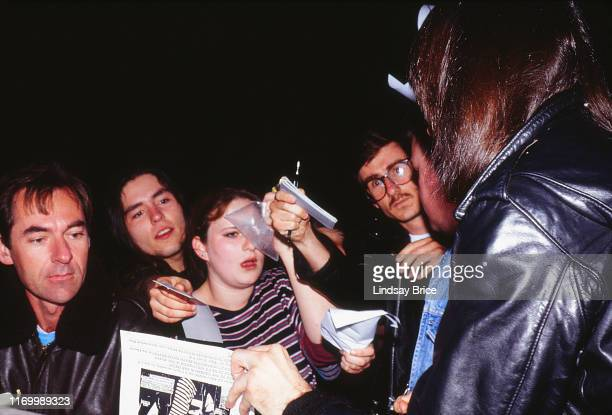 Johnny Ramone signs autographs for fans at stage door after Ramones concert at the Hollywood Palladium on March 11, 1994 in Los Angeles.