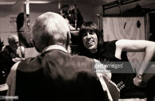 Johnny Ramone smiles as he and Timothy Leary reminisce about listening to baseball on the radio in their boyhoods backstage in dressing room before...