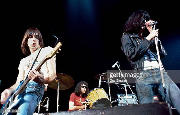 Johnny Ramone , Tommy Ramone and Joey Ramone of The Ramones perform on stage at The Roundhouse, Camden, London, 4th July 1976.
