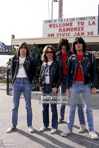 Johnny Ramone Tommy Ramone Joey Ramone and Dee Dee Ramone of the rock and roll band 'The Ramones' pose for a portrait holding letters that spell out...