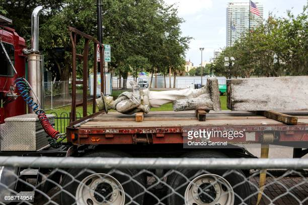 'Johnny Reb' rests on a flatbed truck as workers disassemble the Confederate memorial statue at Lake Eola Park on Tuesday morning June 20 2017 The...