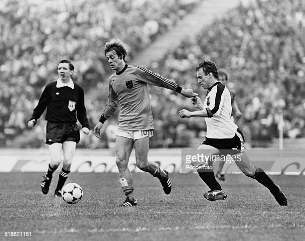 Johnny Rep of the Netherlands moves away from Austrian captain Robert Sara during a World Cup Second Round Group A match at Estadio Chateau Carreras...
