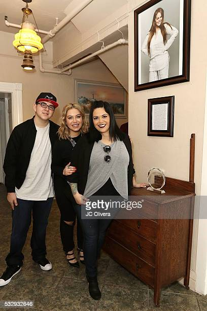 Johnny Rivera singer/tv personality Janney Marin AKA 'Chiquis' Rivera and Jacqie Campos children of the late singer Jenni Rivera during a press...