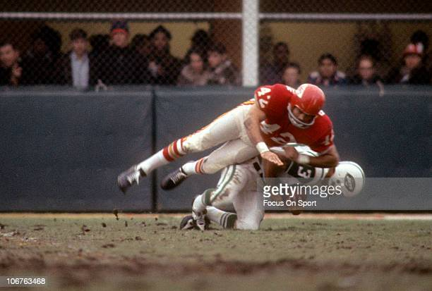 Johnny Robinson of the Kansas City Chiefs tackles Don Maynard of the New York Jets during an NFL football game at Shea Stadium circa 1967 in the...