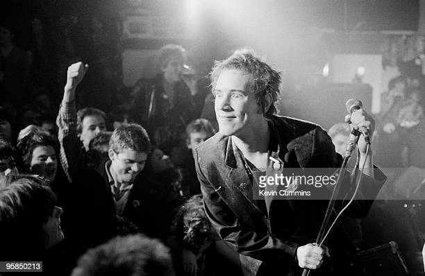 Johnny Rotten of British punk band the Sex Pistols performs on stage at a free concert for the children of striking firefighters held at Ivanhoe's in...