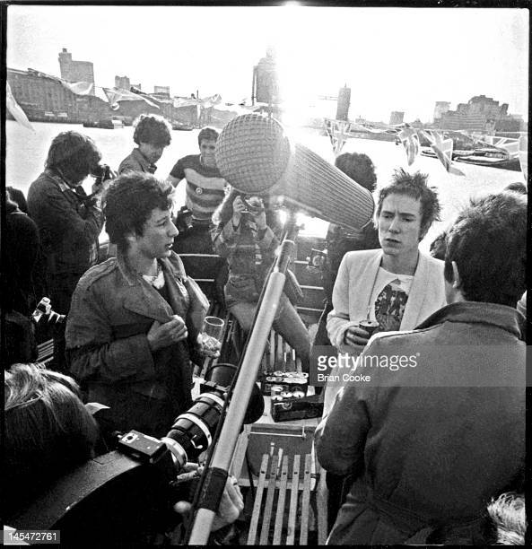 Johnny Rotten of English punk rock band the Sex Pistols being interviewed aboard the Queen Elizabeth on the River Thames on June 7 1977 during their...