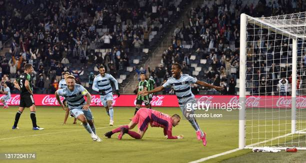 Johnny Russell and Gadi Kinda of Sporting Kansas City celebrate Kinda's go ahead goal during the gqme between Austin FC and Sporting Kansas City at...