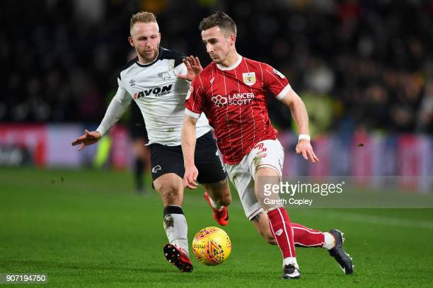 Johnny Russell of Derby challenges Joe Bryan of Bristol City during the Sky Bet Championship match between Derby County and Bristol City at the iPro...