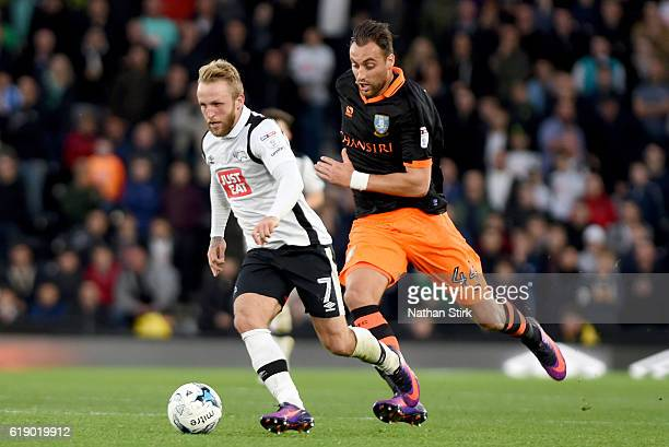 Johnny Russell of Derby County and Atdhe Nuhiu of Sheffield Wednesday in action during the Sky Bet Championship match between Derby County and...
