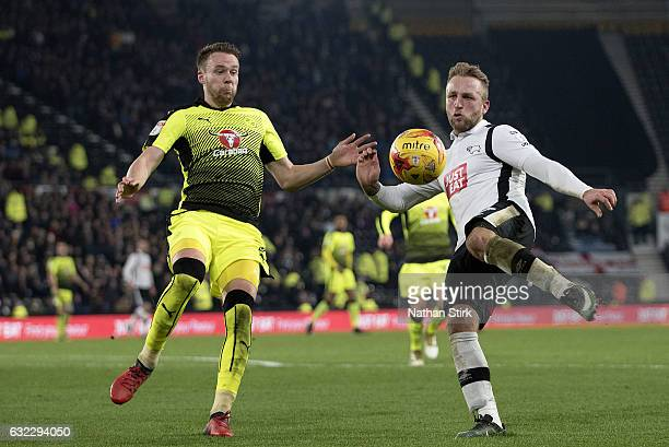 Johnny Russell of Derby County and Chris Gunter of Reading in action during the Sky Bet Championship match between Derby County and Reading at the...