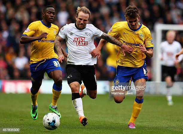 Johnny Russell of Derby County and Emyr Huws of Wigan Athletic challenge for the ball during the Sky Bet Championship match between Derby County and...