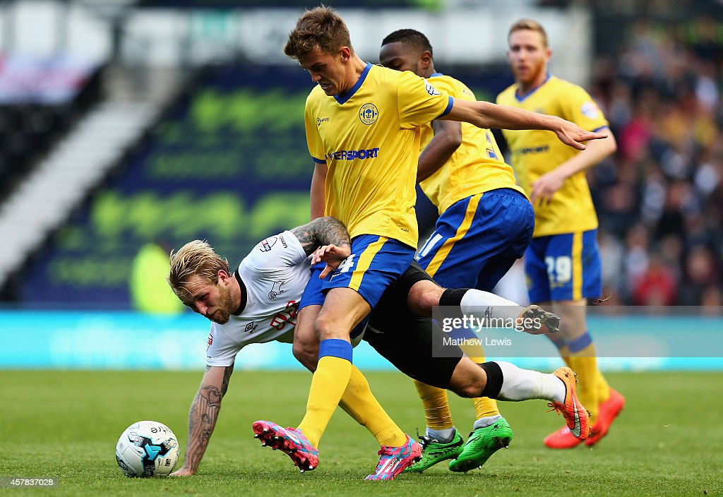 Johnny Russell of Derby County and Emyr Huws of Wigan Athletic challenge for the ball during the Sky Bet Championship match between Derby County and Wigan Athletic at the iPro Stadium on October 25, 2014 in Derby, England.