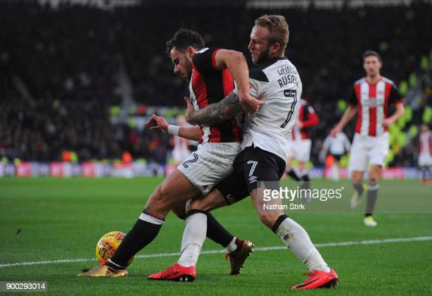 Johnny Russell of Derby County and George Baldock of Sheffield United in action during the Sky Bet Championship match between Derby County and...