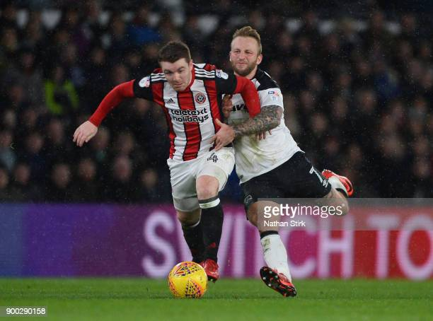 Johnny Russell of Derby County and John Fleck of Sheffield United in action during the Sky Bet Championship match between Derby County and Sheffield...