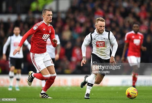 Johnny Russell of Derby County and Thomas Lam of Nottingham Forest in action during the Sky Bet Championship match between Derby County and...