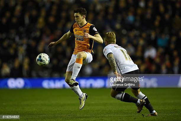 Johnny Russell of Derby County closes down Andrew Robertson of Hull City during the Sky Bet Championship match between Derby County and Hull City on...