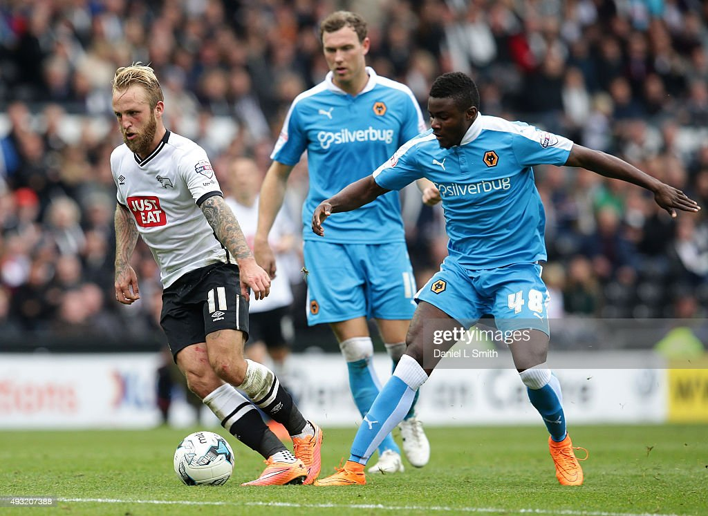 Johnny Russell of Derby County FC maintains control over Bright Enobakhare of Wolverhampton Wanderers FC during the Sky Bet Championship match between Derby County and Wolverhampton Wanderers at Pride Park Stadium on October 18, 2015 in Derby, England.