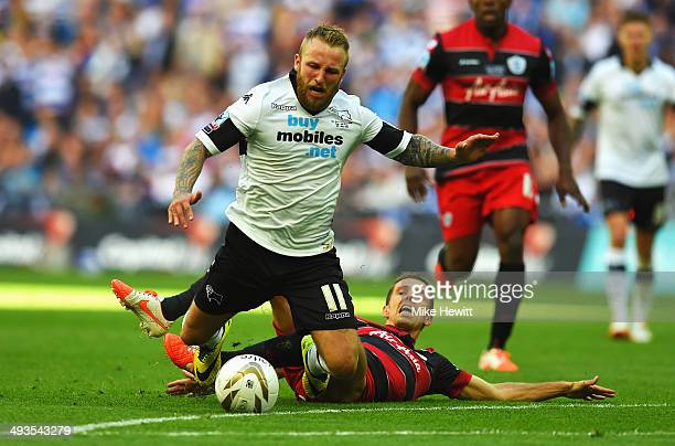 Johnny Russell of Derby County is fouled from behind by Gary O'Neil of Queens Park Rangers during the Sky Bet Championship Playoff Final between...