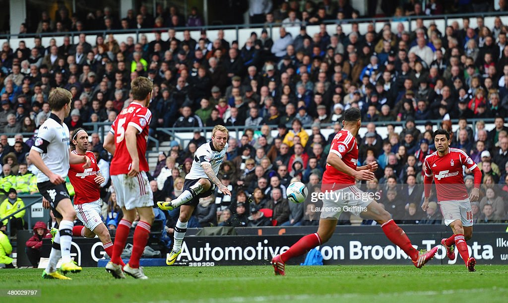 Johnny Russell of Derby County smashes in the fourth goal during the Sky Bet Championship match between Derby County and Nottingham Forest at iPro Stadium on March 23, 2014 in Derby, England.