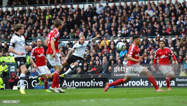 Johnny Russell of Derby County smashes in the fourth goal during the Sky Bet Championship match between Derby County and Nottingham Forest at iPro...