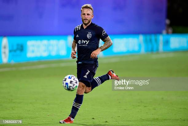 Johnny Russell of Sporting Kansas City controls the ball during a quarterfinals match against Philadelphia Union during the MLS Is Back Tournament at...