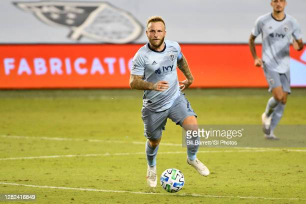 Johnny Russell of Sporting Kansas City dribbles the ball during a game between Nashville SC and Sporting Kansas City at Children's Mercy Park on...