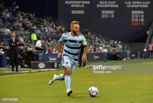 Johnny Russell of Sporting Kansas City dribbles the ball up the right wing during the MLS game between Austin FC and Sporting Kansas City at...