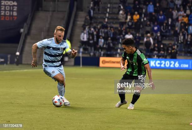 Johnny Russell of Sporting Kansas City tries to get around Daniel Pereira of Austin FC during the gqme between Austin FC and Sporting Kansas City at...