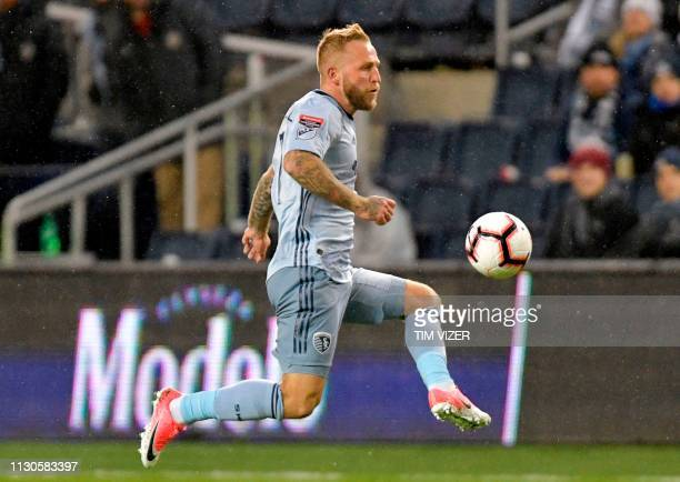 Johnny Russell of Sporting KC leaps and kicks the ball during the CONCACAF Champions League quarterfinal football match between Sporting KC and Club...