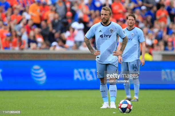 Johnny Russell of the Sporting Kansas City waits for a free kick in the match against the Cincinnati FC during the first half at Nippert Stadium on...