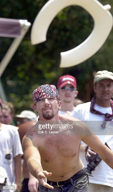 Johnny Sanders tosses a toilet seat in the Redneck Games version of horseshoes at the Seventh Annual Summer Redneck Games July 6, 2002 in East...