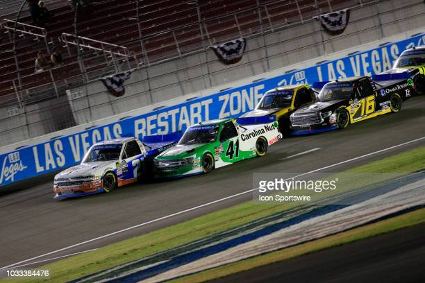Johnny Sauter Allegiant Chevrolet Silverado leads Ben Rhodes The Carolina Nut Co ThorSport Racing Ford F150 during the World of Westgate 200 NASCAR...