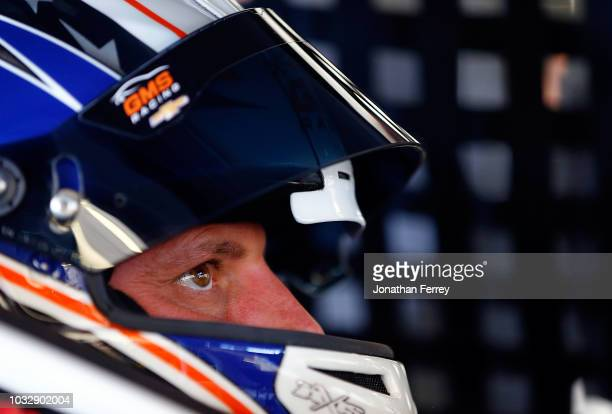 Johnny Sauter driver of Allegiant Chevrolet in the garage during practice for the NASCAR Camping World Truck Series World of Wesgate 200 on September...