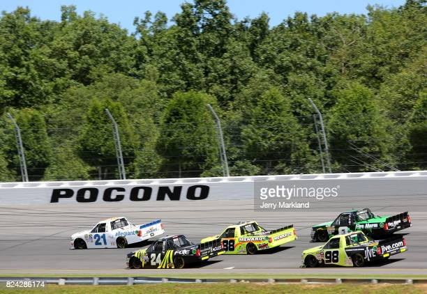 Johnny Sauter driver of the Allegiant Airlines Chevrolet and Justin Haley driver of the Fraternal Order of Eagles Chevrolet lead a pack of trucks...