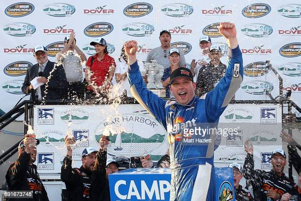 Johnny Sauter driver of the Allegiant Airlines Chevrolet celebrates in Victory Lane after winning the NASCAR Camping World Truck Series Bar Harbor...