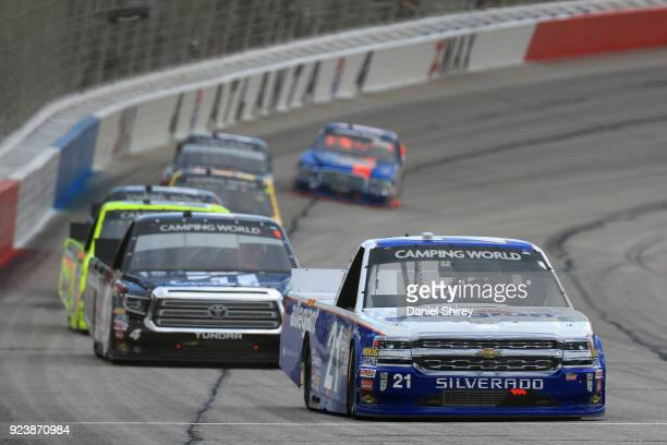 Johnny Sauter driver of the Allegiant Airlines Chevrolet leads a pack of trucks during the NASCAR Camping World Truck Series Active Pest Control 200...