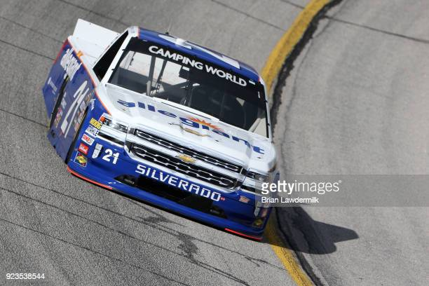 Johnny Sauter driver of the Allegiant Airlines Chevrolet practices for the NASCAR Camping World Truck Series Active Pest Control 200 at Atlanta Motor...