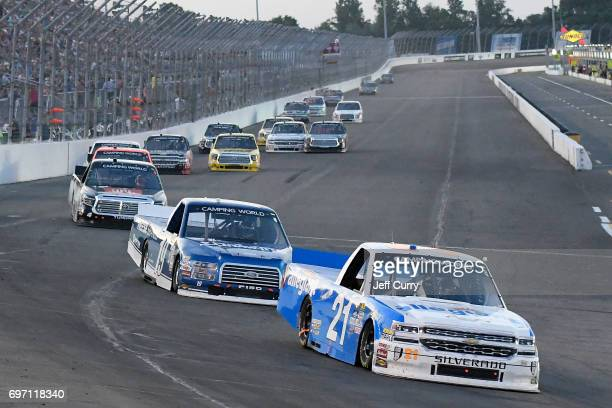 Johnny Sauter driver of the Allegiant Airlines Chevrolet Silverado leads a pack of trucks during NASCAR Camping World Trucks Series Drivin' for...