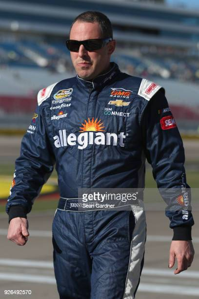 Johnny Sauter driver of the Allegiant Airlines Chevrolet stands by his truck during qualifying for the NASCAR Camping World Truck Series Stratosphere...