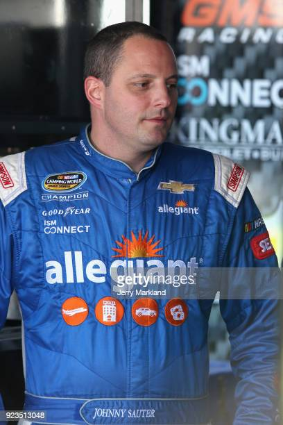 Johnny Sauter driver of the Allegiant Airlines Chevrolet stands in the garage area during practice for the NASCAR Camping World Truck Series Active...