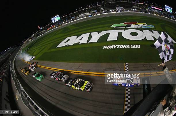Johnny Sauter driver of the Allegiant Airlines Chevrolet takes the checkered flag to win the NASCAR Camping World Truck Series NextEra Energy...