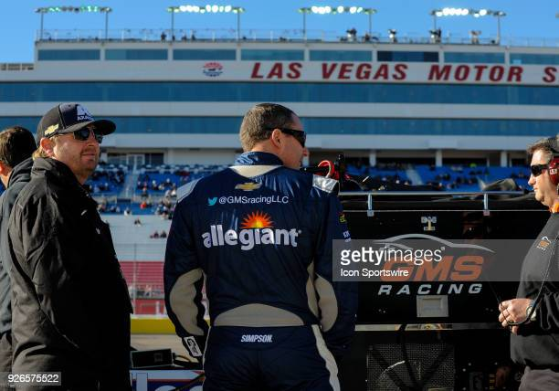 Johnny Sauter driver of the Allegiant Airlines Chevrolet talks with his crew during the Startosphere 200 qualifying on March 2 2018 at Las Vegas...