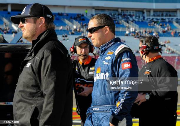 Johnny Sauter driver of the Allegiant Airlines Chevrolet walks with his crew during the Startosphere 200 qualifying on March 2 2018 at Las Vegas...